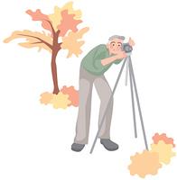 紅葉をとる年配の男性