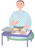 浴衣で夕食を食べる男性