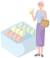 買い物をする年配の女性