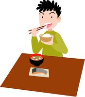 ご飯を食べる少年