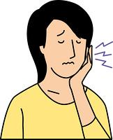 歯痛に苦しむ20代女性