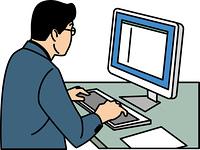パソコンを操作する40代ビジネスマン