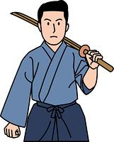 剣道着を着て木刀を持つ30代男性