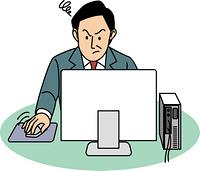 パソコンでイライラする50代ビジネスマン