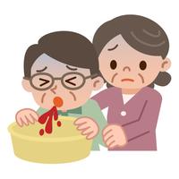 吐血するシニア男性と介抱するシニア女性