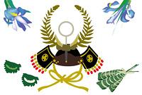 子供の日の兜と粽と柏餅と菖蒲の花