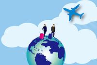 海外旅行に出かけるカップルと地球と飛行機