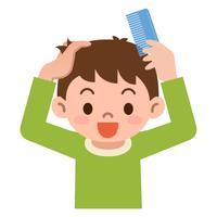 櫛で髪をとかす男の子