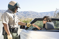 Highway patrol officer with female driver