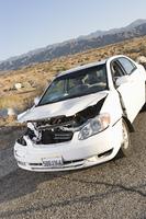 Damaged car in desert