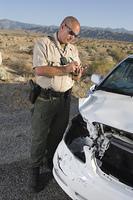Police officer takes car crash details