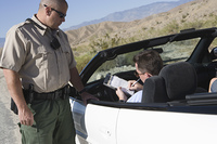 Male driver fills out patrol ticket