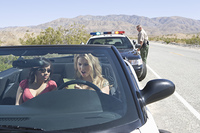 Female drivers pulled over by police officer