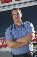 Portrait of paramedic by ambulance