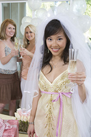 Bride celebrating at bridal shower with friends