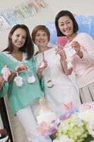 Pregnant Woman with Mature Women at a Baby Shower