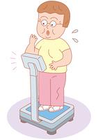 体重計の数値に驚く女性