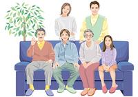 ソファに腰掛ける家族