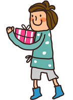 Side view of boy holding gift