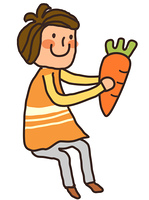 Side view of boy holding carrot