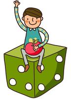 Close-up of boy sitting on dice