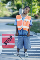 Portrait of boy on cross walk duty