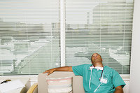 Male doctor relaxing on couch
