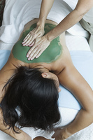 High angle view of woman receiving massage