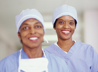 Two female surgeons smiling