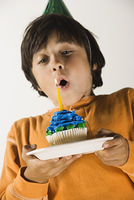 Boy with birthday cupcake