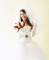 Young bride posing with wedding bouquet