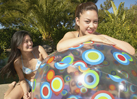 Two women with beach ball