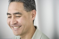 Middle-aged Asian man smiling