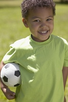 African boy holding soccer ball
