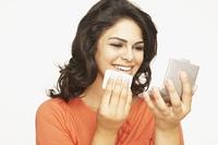 Hispanic woman applying make up
