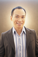 Middle-aged Asian man wearing suit jacket
