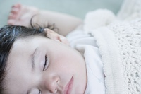 Close up of Hispanic baby sleeping
