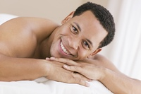 Portrait of African man on massage table