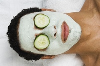 Mixed Race man receiving spa facial treatment