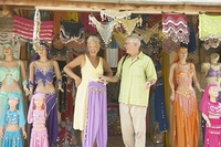 Senior couple looking at belly dancing outfits