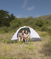 Couple posing outside their tent