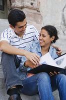 Hispanic couple laughing outdoors