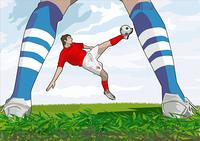 Football player scissor kicking ball towards goalkeeper