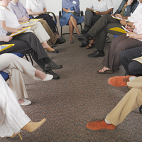 Detail view of business people's legs in conference