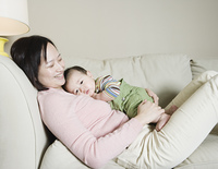 Asian mother and baby on the sofa