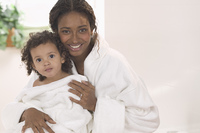 Portrait of mother and daughter in bathrobes