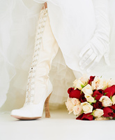 Bride's white boots and wedding bouquet