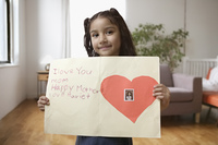 Portrait of girl holding Mother's Day card