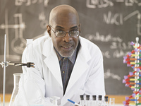 African male science teacher in front of the blackboard, Toronto, Canada