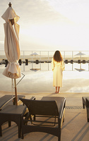 Woman in bathrobe outdoors at resort hotel,Los Cabos,Mexico